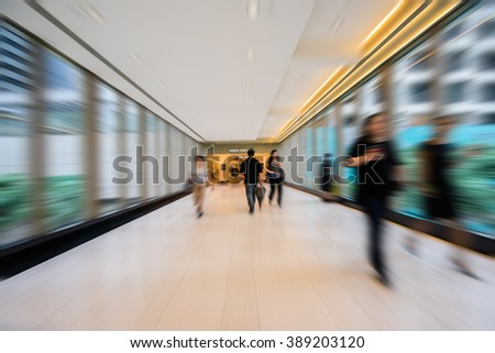 people walking in corridor