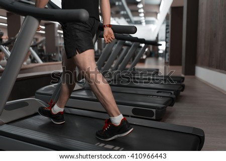 People walking in machine treadmill at fitness gym club