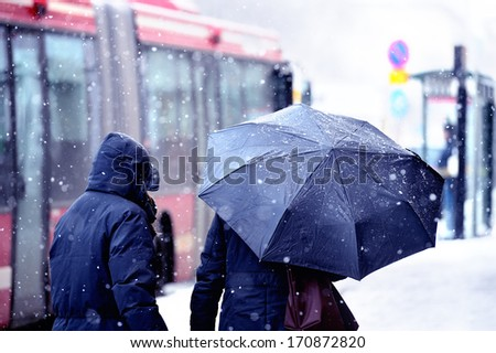 People walking in snow storm - stock photo