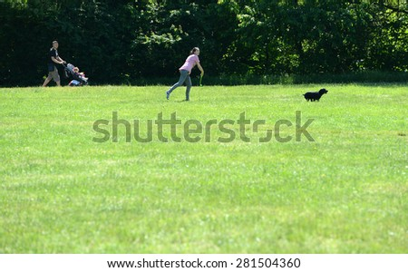 People walking in spring day in the park in Sofia, Bulgaria on may 25, 2015 - stock photo