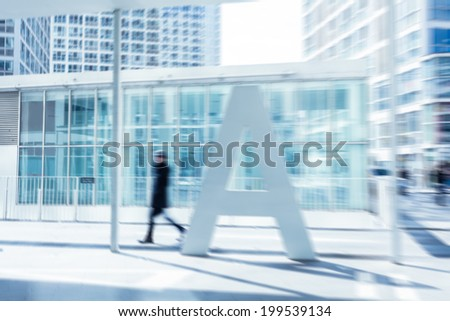 People walking in the business district - stock photo