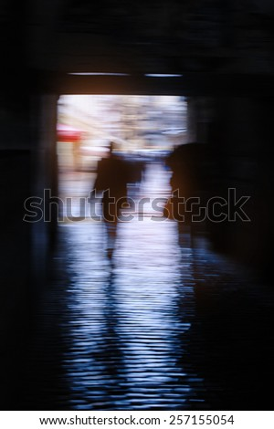people walking in the transition oiled focus. - stock photo
