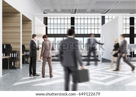 People Walking Near Office Cubicles In An With White And Wooden Walls There Are