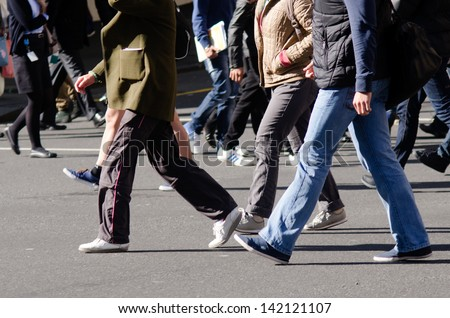 People walking on big city street, blurred motion crossing abstract