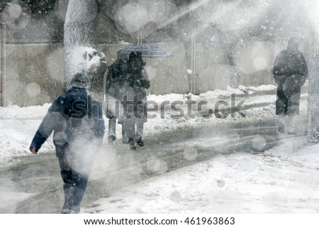 people walking on street during snowing in winter time.