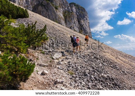People walking on the  Prince's Stone mountain path, in the romanian South Carpathians - stock photo