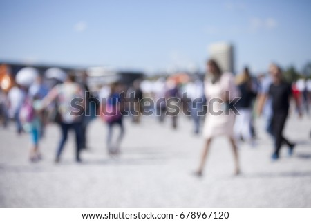 People walking on the promenade- blurred background
