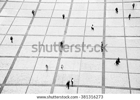 People walking on the Sofiyivsky square in Kiev, Ukraine. motion blur