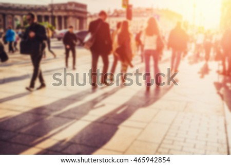People walking on the street. Blurred effect.