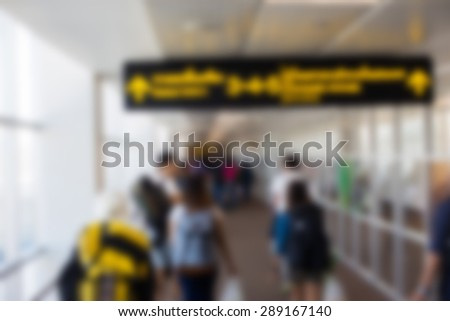People walking to the gate of the airport transfer - stock photo
