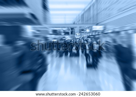 People walking to the gate of the airport transfer. Radial blur. - stock photo