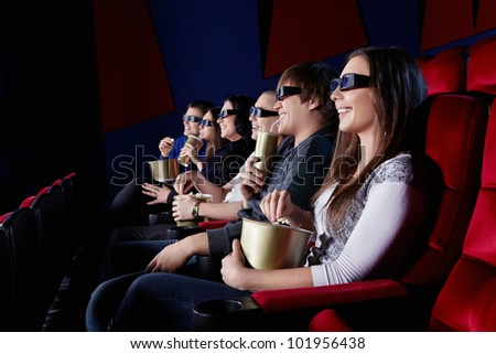 People watch a movie in 3D glasses in the cinema - stock photo