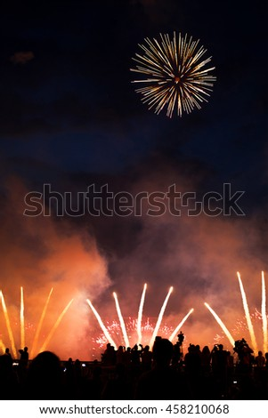 People watch fireworks on holiday and photographed