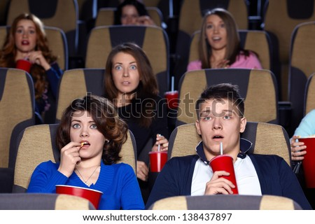 People watching movie at the cinema
