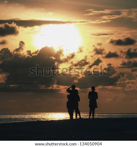 People watching sunset on Maldives
