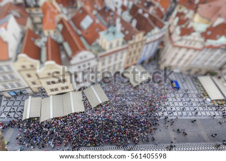 People watching the astronomical clock in the Old Town Square, Prague, Czech Republic