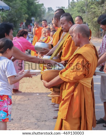 People were bringing food to the monks during the morning.Buriram,Thailand,April 2013