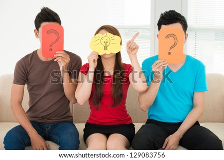 People with cards with symbols instead of their heads