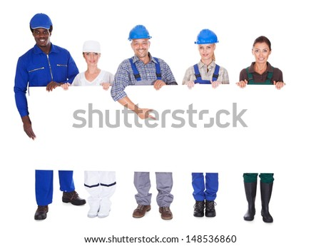 People With Diverse Professions Holding Placard Over White Background - stock photo