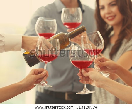 People with glasses of red wine, closeup