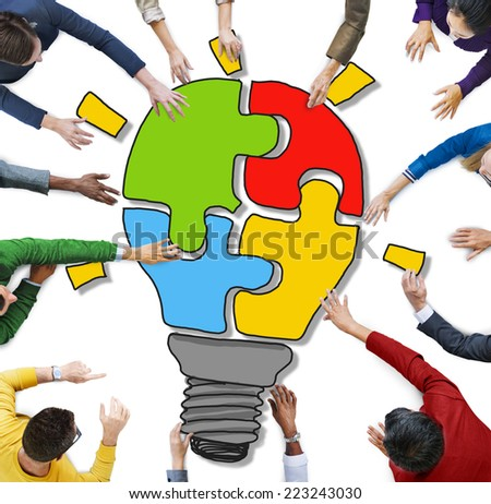People with Jigsaw Puzzle Forming Light Bulb in Photo and Illustration - stock photo