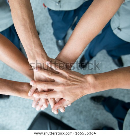 People with their hands together. team work concept - stock photo