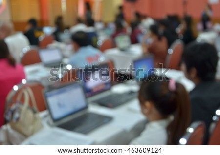 People work with their computer in a meeting room