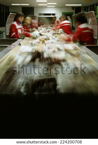 People working in assembly line, blurred - stock photo