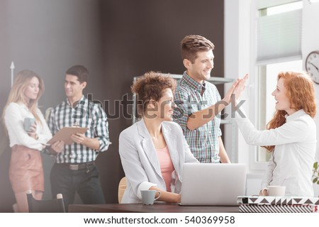 People working in positive environment, woman using laptop