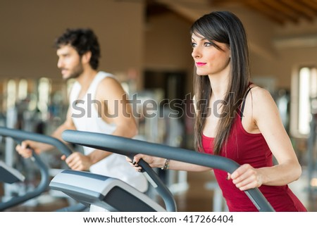 People working out in a gym - stock photo