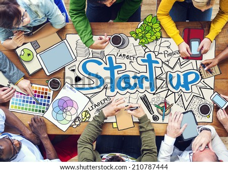 People Working with Photo Illustrations of Startup Business - stock photo