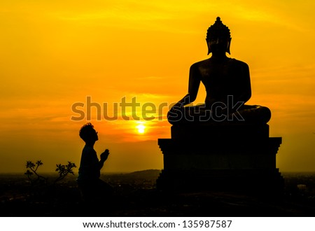 People worship Buddha, Buddha statue on sunset sky background