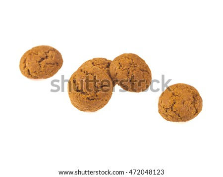 Pepernoten cookies in a row seen from above as Sinterklaas decoration on white background for dutch sinterklaasfeest holiday event on december 5th