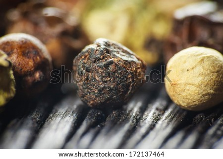 pepper corns on a wooden board