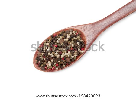 pepper in wooden spoon  isolated on white background