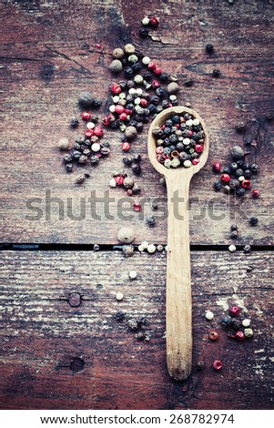 pepper in wooden spoon/ mixture of peppers hot pepper, red pepper, black pepper, white pepper, green pepper, background - stock photo