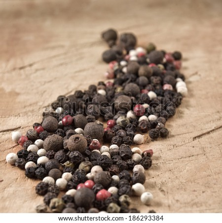 pepper on an old wooden background