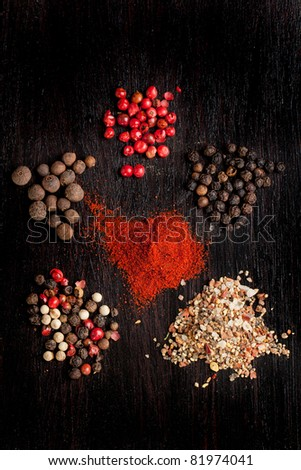 Pepper's mix on black table - stock photo