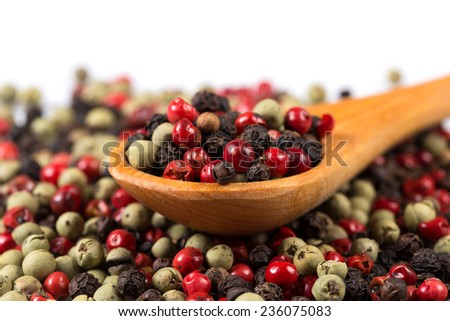Pepper seasoning mix in wooden spoon isolated on white background cutout