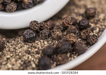 pepper seeds and powder - stock photo