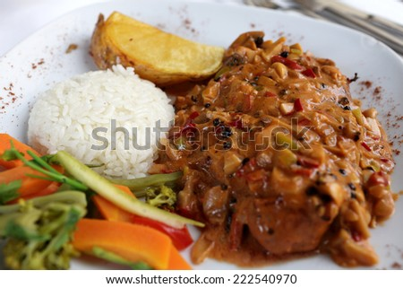 Pepper steak with rice on a plate  - stock photo