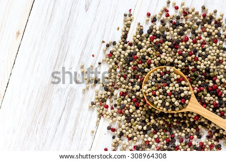 Peppercorn mix with spoon on wooden table background.Top view with copy space. - stock photo