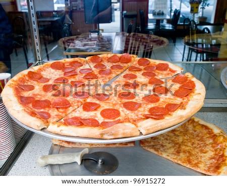 Pepperoni on display - stock photo