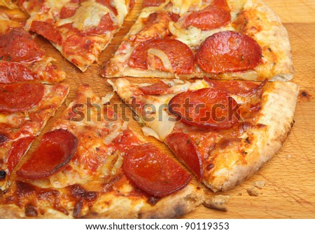 Pepperoni pizza cut into slices.