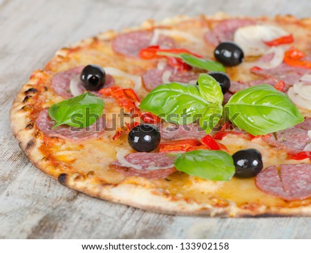 Pepperoni pizza on a wooden table