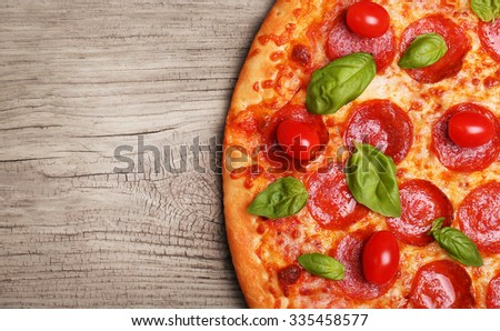 Pepperoni pizza on wooden background