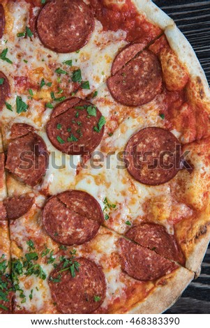 Pepperoni pizza on wooden table