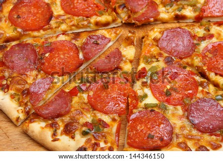 Pepperoni pizza with red and green chillies.