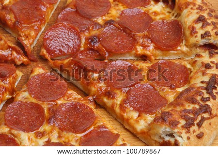 Pepperoni pizza with sauce stuffed crust
