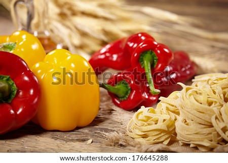 Peppers and Pasta on old wood table